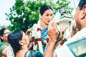 Jasmine flowers were the cultural giveaway at the wedding of a Korean girl to a Tamilian man, documented by photographer Mahesh Shantaram.