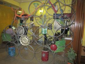 Room divider made of old bicycle wheels at Sweccha's Delhi office.