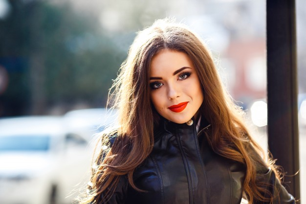 happy-young-woman-with-red-lipstick_1153-396